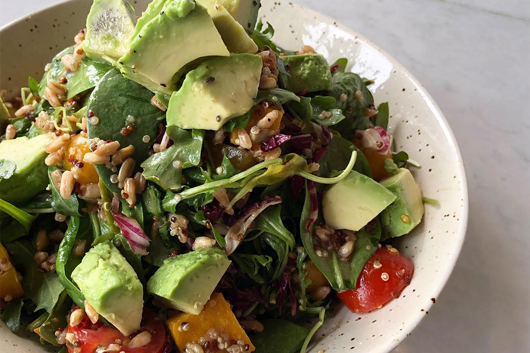 Grain Bowl with fresh spinach and avocado lime dressing